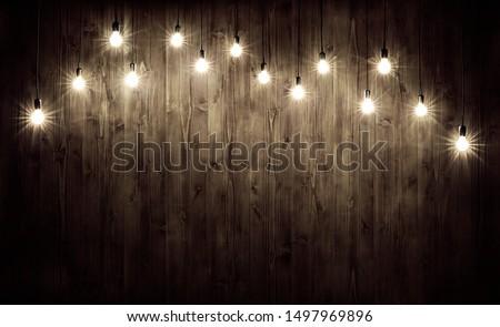 Light bulbs on dark wooden background