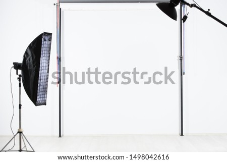 Empty photo studio with lighting equipment #1498042616