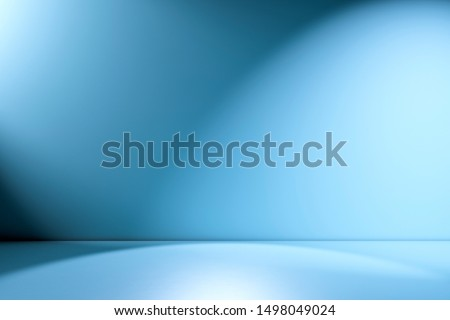 Blue empty Studio room for product placement or as a design template with wall angle in a full frame view