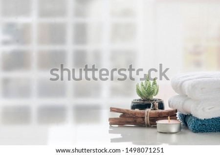 Spa aromatherapy concept with stack of clean towels on white table background, copy space. #1498071251