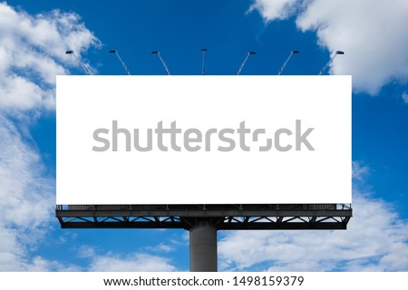 Mockup Large white blank billboard or white promotion poster displayed on the outdoor against the blue sky background. Promotion information for marketing announcements and details #1498159379