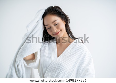Asian women are using a dry towel to dry their hair.after showering #1498177856