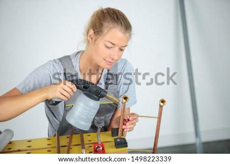 a woman using heat gun #1498223339