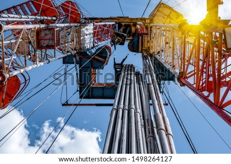 Oil and Gas Drilling Rig. Oil drilling rig operation on the oil platform in oil and gas industry #1498264127