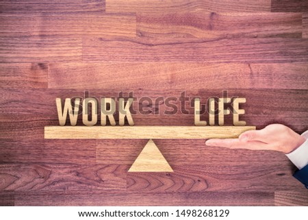 Work life (work-life) balance concept. Helping hand of personal coach helps with work and life balance. #1498268129