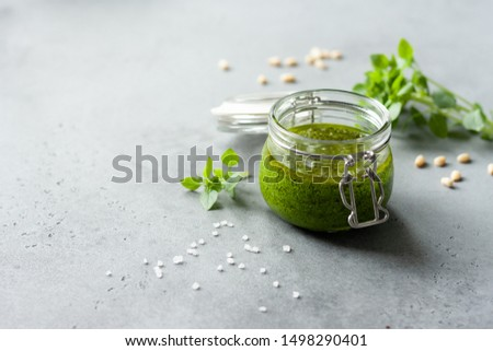 Traditional italian sauce pesto with green basil on grey background  #1498290401