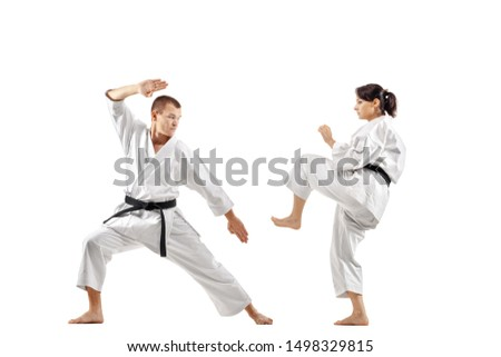 karate girl and boy fighting against white background Royalty-Free Stock Photo #1498329815