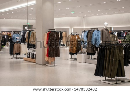 Modern fashionable brand interior of clothing store inside shopping center Royalty-Free Stock Photo #1498332482