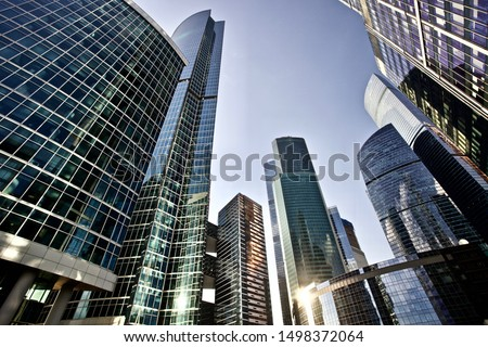 Office and residential skyscrapers on bright sun and clear blue sunset sky background. Commercial real estate. Modern business city district. Office buildings exterior. Financial city district.  #1498372064