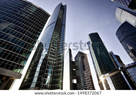 Office and residential skyscrapers on bright sun and clear blue sunset sky background. Commercial real estate. Modern business city district. Office buildings exterior. Financial city district.  Royalty-Free Stock Photo #1498372067