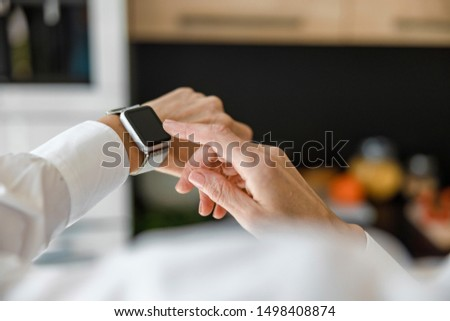 Close up of screen of smartwatch on woman hand stock photo #1498408874