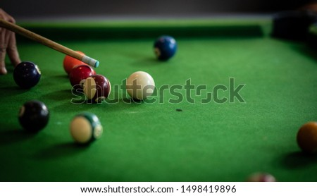 A group of people playing snooker whilst enjoying a drink #1498419896