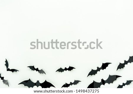 Table top view aerial image of decoration Happy Halloween day background concept.Flat lay accessories essential object to party the bat fly on white wooden wallpaper.Copy space for creative design.