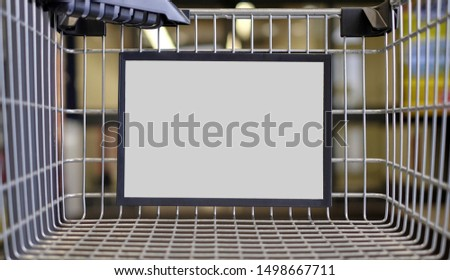 Closeup of a advertising sign in a Shopping cart. Horizontal image with copy space.