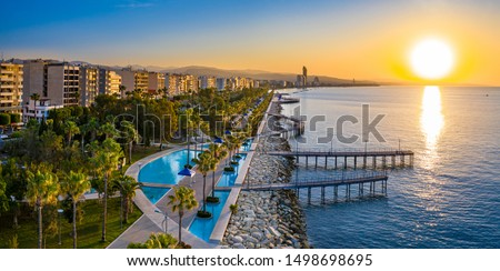 Sunset in Cyprus. The sun sets in the Mediterranean. Limassol at sunset. Evening panorama of Limassol with height. Mediterranean evening landscape. Holidays in Cyprus. #1498698695