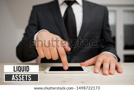 Conceptual hand writing showing Liquid Assets. Business photo showcasing Cash and Bank Balances Market Liquidity Deferred Stock. #1498722173