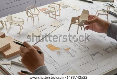 Designer sketching drawing design development product plan draft chair armchair Wingback Interior furniture prototype manufacturing production. designer studio concept .                            #1498742522
