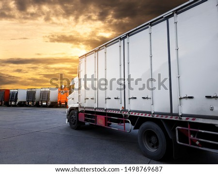 freight industry, logistics transportation, trucks parking at sunset sky #1498769687