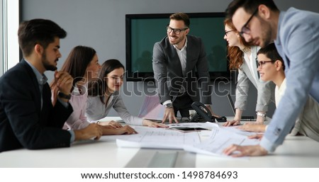 Group of business people collaborating in office #1498784693
