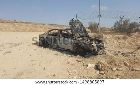 A wrecked car in the desert Royalty-Free Stock Photo #1498805897