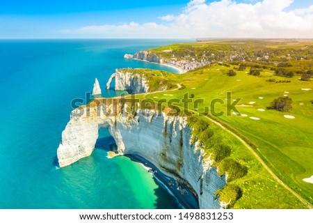 Picturesque panoramic landscape on the cliffs of Etretat. Natural amazing cliffs. Etretat, Normandy, France, La Manche or English Channel. Coast of the Pays de Caux area in sunny summer day. France #1498831253
