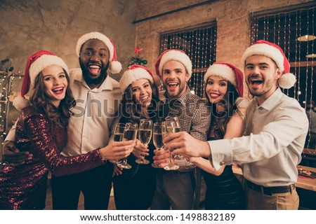 Portrait of cheerful buddies  cheering chilling celebrate christmas time enjoy x-mas midnight give toast in house with noel decoration indoors #1498832189