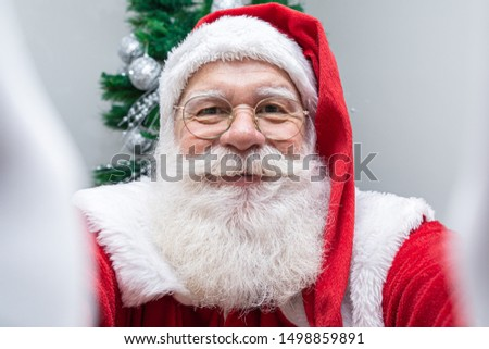 Santa Claus making selfie photos. Christmas night. Gift delivery. Enchanted dreams of children.