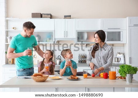 Happy family having breakfast with toasts in kitchen #1498880690