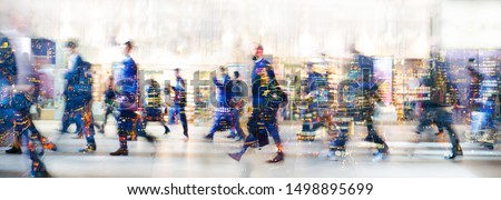 London, UK. Crowd of people walking at work in early morning. Concept wide background with  space for text. Multiple exposure image Royalty-Free Stock Photo #1498895699