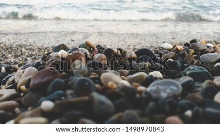 Pebble beach and sea waves in the evening. #1498970843