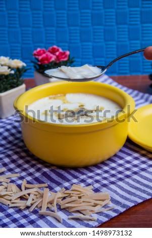 a bowl of noodle soup with milk #1498973132