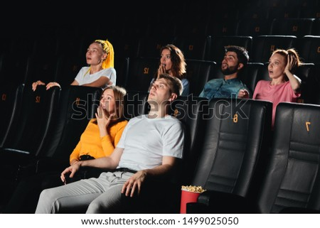 audience doesn't feel comfortable at the cinema, young people with funny reaction during session #1499025050