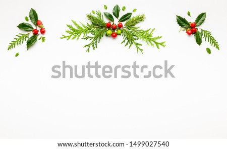 Christmas composition  with branches of spruce and holly with red berries on white background. Merry christmas greeting card with empty space for holiday text. Flat lay. #1499027540