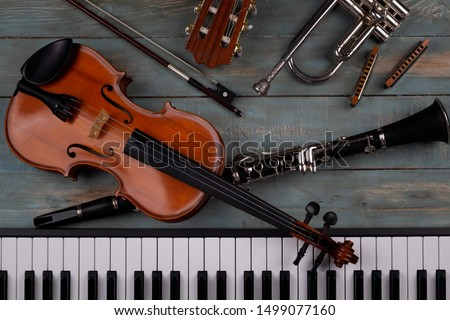 musical instruments in wooden background #1499077160
