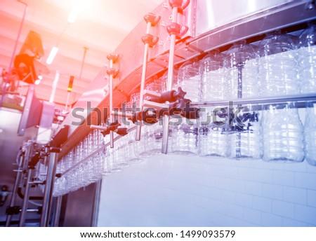 The plastic bottle blowing machine. PET preforms for blowing of plastic bottles. Heating process. High technology #1499093579
