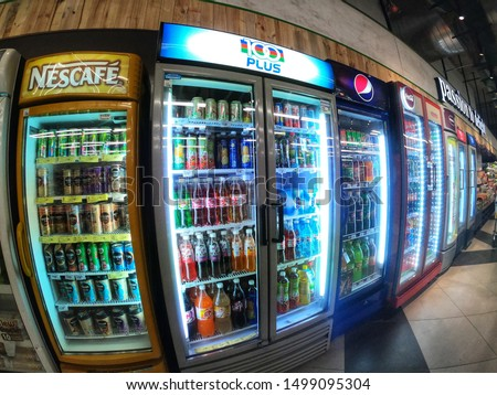 Shah Alam, Malaysia - 12 August 2019 : Soft drinks inside refrigerator on aisle for sell in a supermarket with selective focus.Wide angel photoghpy.    #1499095304