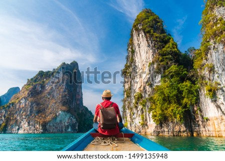 Man traveler on boat joy look nature rock island scenic landscape Khao Sok National park, Adventure famous place tourist travel Thailand Tourism beautiful destination Asia holiday summer vacation trip #1499135948