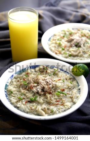 Photo of chicken porridge also known in the Philippines as chicken lugaw or arroz caldo #1499164001