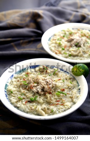 Photo of chicken porridge also known in the Philippines as chicken lugaw or arroz caldo #1499164007