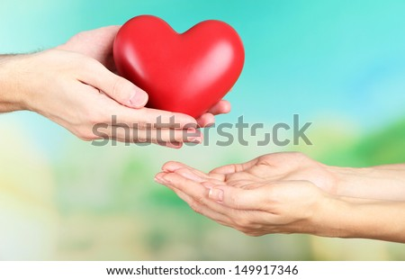 Heart in hands on nature background #149917346