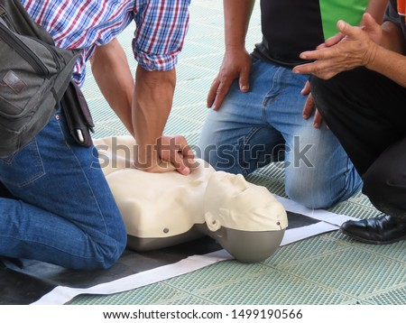 Training activities on first aid methods to let people know CPR. #1499190566