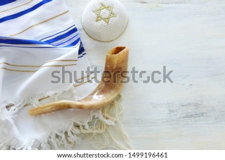 religion image of Prayer Shawl - Tallit, Prayer book and Shofar (horn) jewish religious symbols. Rosh hashanah (jewish New Year holiday), Shabbat and Yom kippur concept. #1499196461