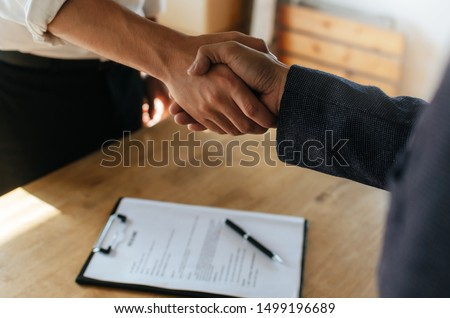Partnership. two business people shaking hand after business signing contract in meeting room at company office, job interview, investor, success, negotiation, partnership, teamwork, financial concept #1499196689