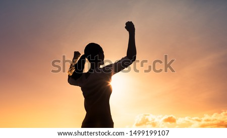 Strong woman flexing her arms. People feeling powerful, inner strength, victory, and hero concept. Royalty-Free Stock Photo #1499199107