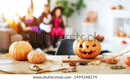 happy Halloween! the pumpkin Jack lantern with carved smile for family holiday at  home Royalty-Free Stock Photo #1499248274