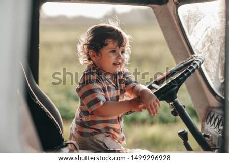 Little Baby driving a truck #1499296928