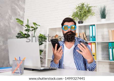 There is always talent shortage. Man freak crazy manager having phone call while drinking coffee. Freak managing projects. Office freak. Weirdo at workplace. Toleration of weirdos. Caffeine influence. #1499327441