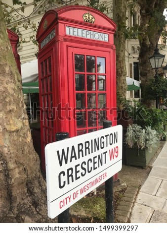 Westminster, London / England - August 2019 : General view of Warrington Crescent street in Westminster with a public telephone box. #1499399297