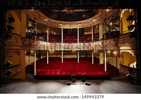 View of an empty theatre with red seats and balcony #149941079