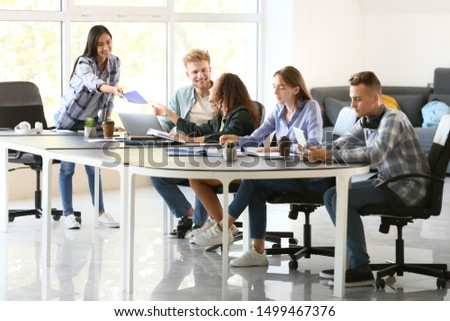 Group of students preparing for exam in university #1499467376